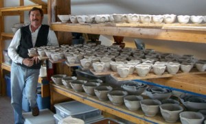 "Robert with ""green ware"" pots."