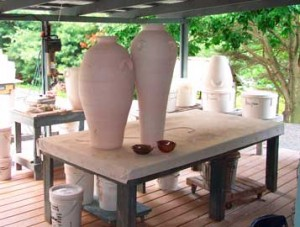 Large bisque fired urns.