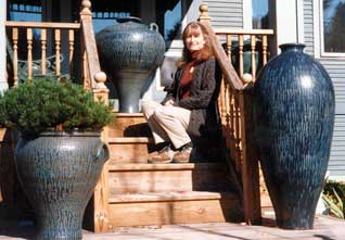 Christine sitting with big pots.